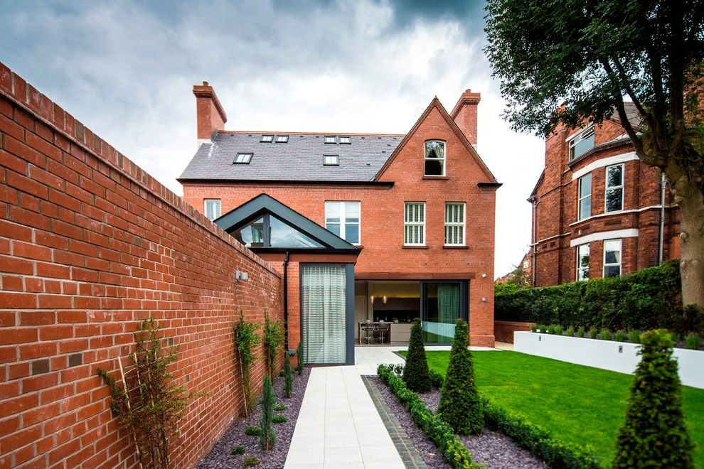 Barber Appointment App with Transitional Exterior  and Back Garden Brick Fence Brick Garden Wall Garden Wall Landscaping Terraced Garden London Rear Garden Red Brick Red Brick House Red Brick Wall Skylights Sliding Glass Doors Updated Traditional