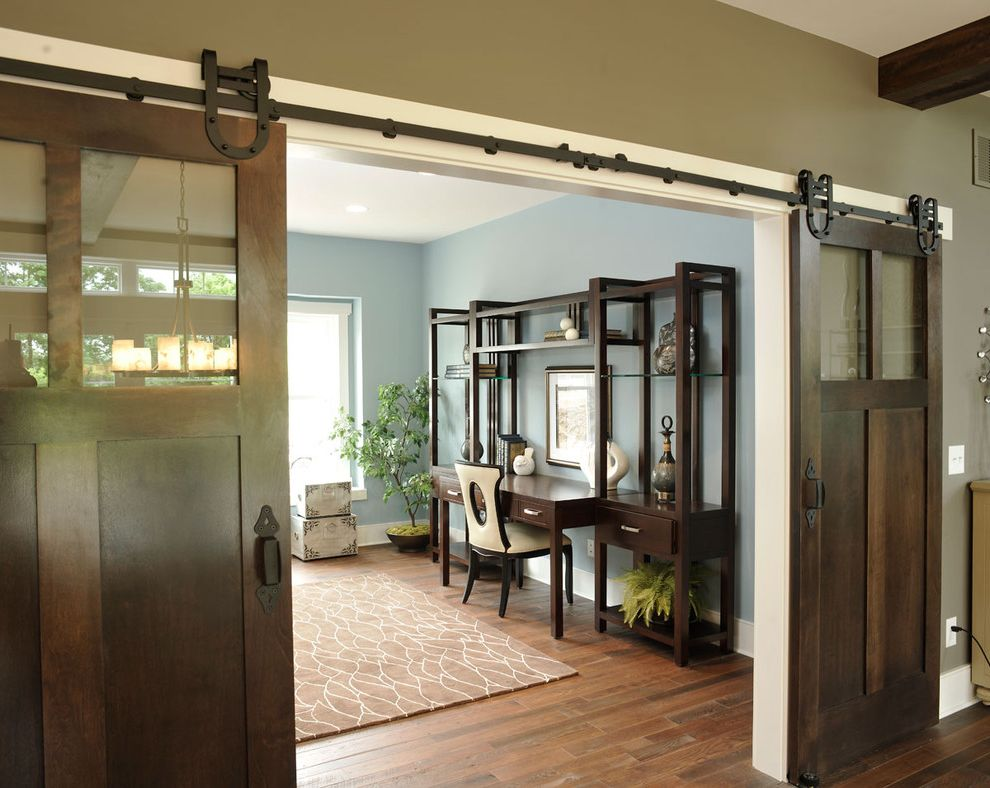 Barn Doors Dallas with Traditional Home Office  and Area Rug Barn Doors Baseboards Blue and Brown Blue Walls Dark Floor House Plants Sliding Doors White Wood Wood Flooring Wood Trim Wooden Desk