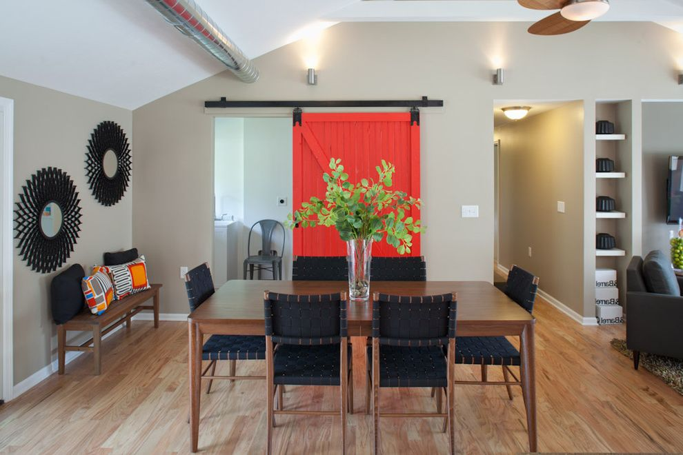 Barn Doors Dallas with Transitional Dining Room Also Area Rug Arm Chair Bench Seat Ceiling Fan Exposed Ducting Gray Open Shelving Red Barn Sliding Door Seating Area Starburst Mirrors Vaulted Ceiling Wood Floor Woven Chairs