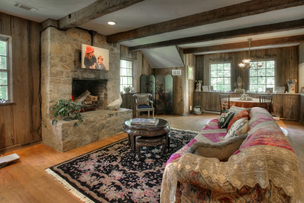 Barnwood Paneling   Farmhouse Living Room  and Area Rug Carriage House Garage Apartment Hemlock Lace Portrait Rustic Stone Fireplace Stone Hearth Wood Beams Wood Floor Wood Paneling