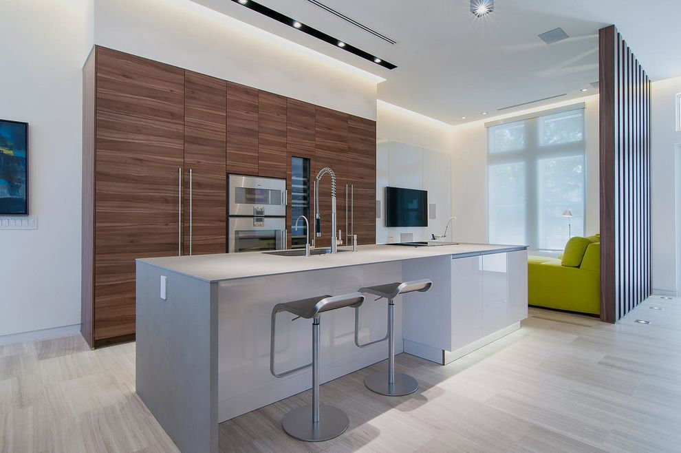 Barons Appliance with Contemporary Kitchen  and Bar Stools Beige Floor Tile Gray Countertop Green Sofa Waterfall Countertop
