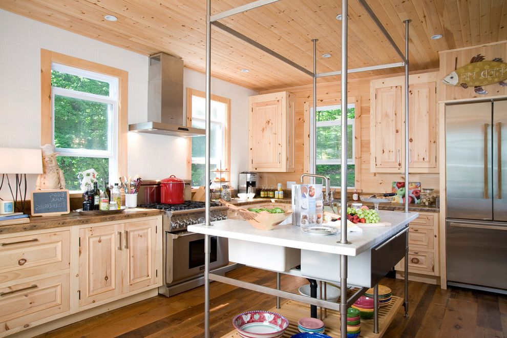 Barons Appliance with Rustic Kitchen  and Cabin Ceiling Lighting Double Hung Windows Kitchen Island Range Hood Recessed Lighting Rustic Stainless Steel Appliances Wood Cabinets Wood Flooring Wood Molding Wood Paneling