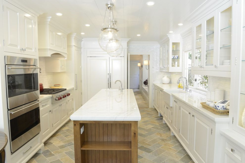 Barons Appliance with Traditional Kitchen  and Glass Pendant Lights Globe Pendant Lights Herringbone Floor Recessed Lighting Wall Ovens White Countertop Wood Island