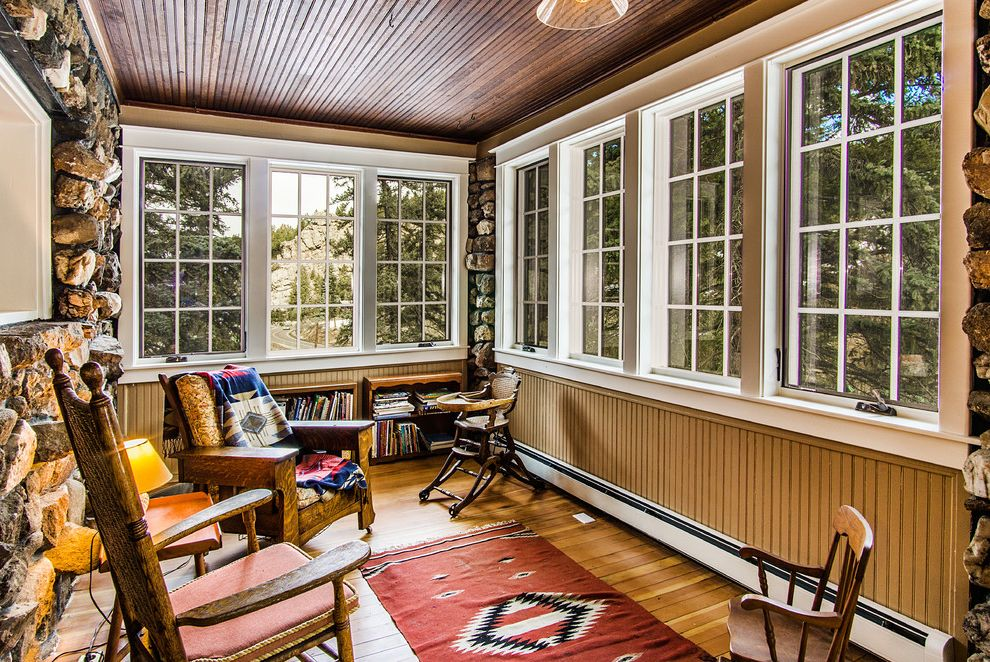 Baseboard Heat Covers with Rustic Sunroom  and Addition Boulders Cabin Renovation Restoration Rocking Chair Rustic Sunroom Small Bookcase Southwestern Carpet Runner Stone Siding Wood Armchairs Wood Ceiling