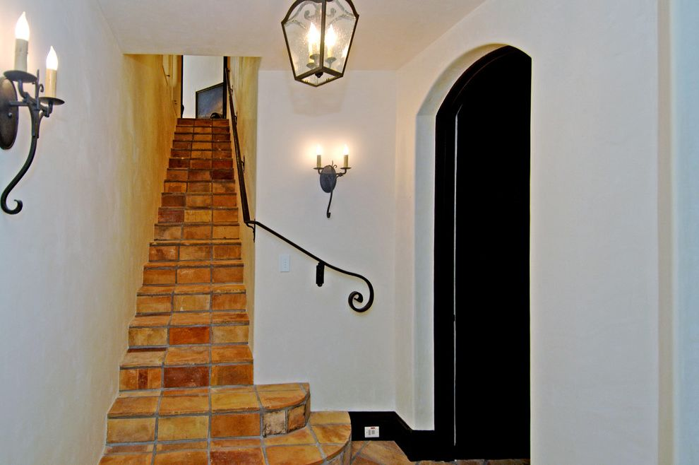Basement in Spanish   Mediterranean Staircase Also Arch Doorway Black Baseboard Black Staircase Rail Chandelier Handrail Hanging Lantern Iron Lantern Plaster Sconce Spanish Staircase Tile Tile Steps Traditional Wall Sconce