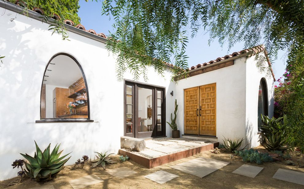 Basement in Spanish with Mediterranean Entry  and Arch Window Double Wood Doors L Shape Mediterranean Plants Pavers Roof Tile Spanish Colonial Step Stucco