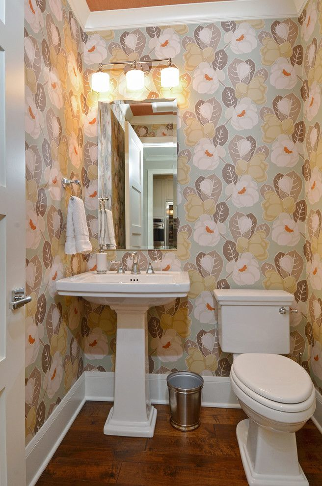 Basement Toilet   Traditional Powder Room  and Floral Wallpaper Frameless Mirror Trash Can Triple Wall Sconce Widespread Faucet