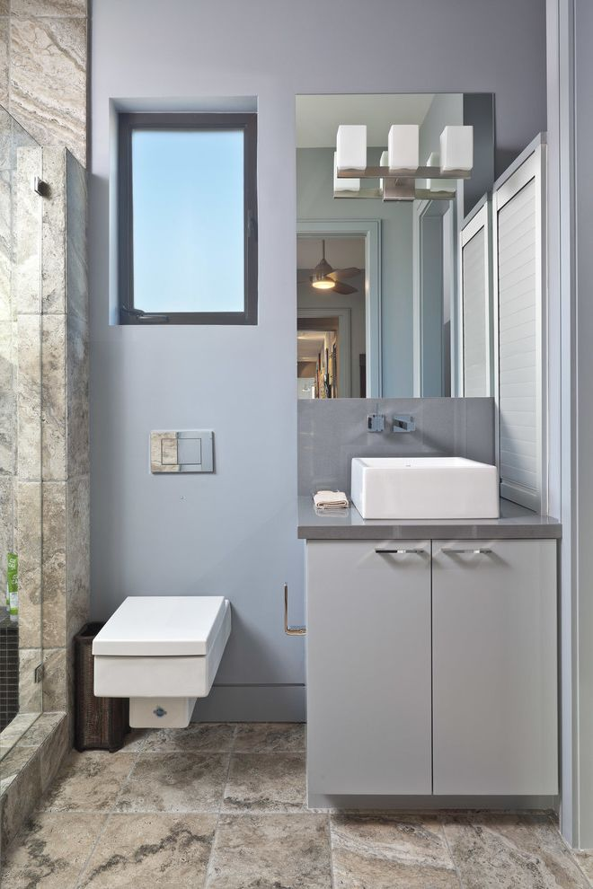Basement Toilet with Contemporary Bathroom  and Compact Elegant Frame Less Shower Frameless Frosted Window Grey Modern Sconce Shower Simple Subdued Tile Floor Wall Mounted Toilet
