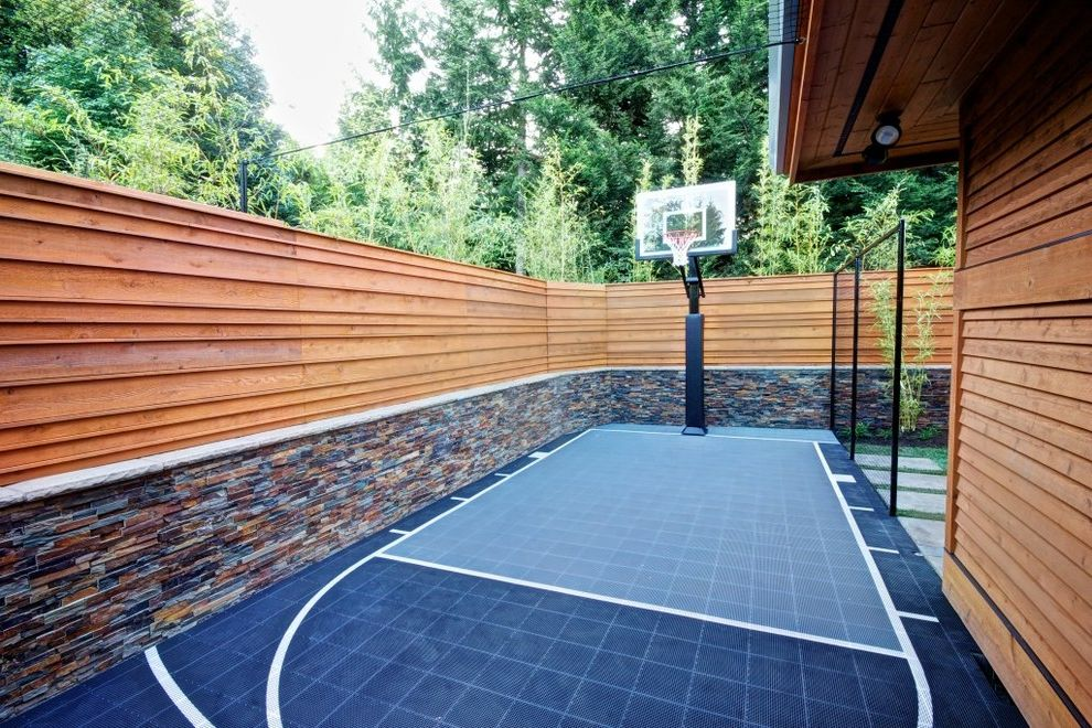 Basketball Barrier Nets with Contemporary Landscape  and Basket Ball Court Basketball Court Half Court Side Yard Sport Court Stacked Stone Wall Wood Fence Wood Siding