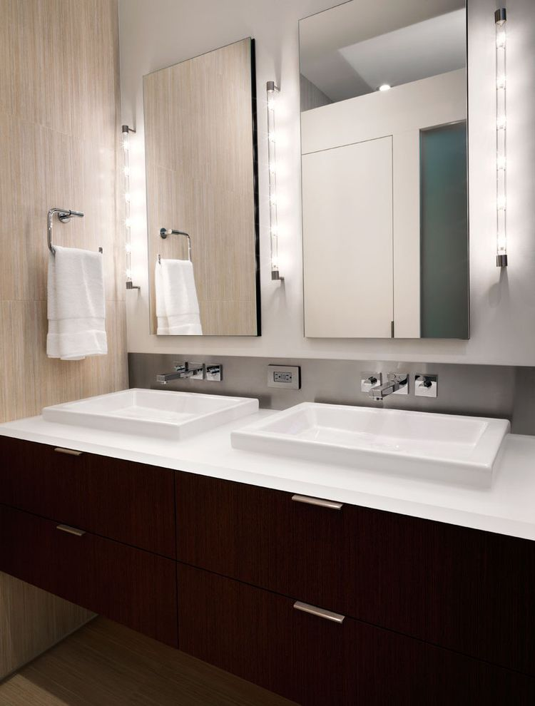 Bathroom Light Fixture with Outlet Plug   Contemporary Bathroom  and Bathroom Hardware Bathroom Lighting Bathroom Mirror Double Sinks Floating Vanity Minimal Neutral Colors Shared Bathroom Square Sinks Towel Bar Wall Mount Faucet