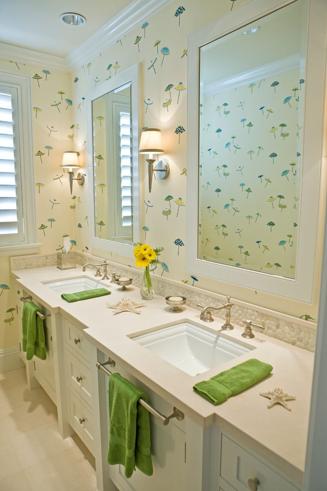 Bathroom Towel Bar Height with Beach Style Bathroom  and Beige Countertop Beige Floor Tile Double Sink Vanity Two Sinks Wall Sconces Wallpaper White Framed Mirror Widespread Faucet