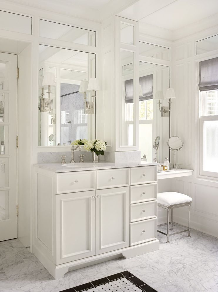 Bathroom Vanity with Makeup Station with Traditional Bathroom  and Accent Floor Tile Upholstered Stool Wall of Mirrors Wall Sconce White Countertop White Floor Tile