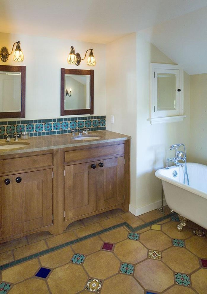 Bathrooms in Spanish   Rustic Bathroom  and Baseboards Bathroom Lighting and Vanity Lighting Claw Foot Tub Double Sinks Double Vanity Freestanding Tub Medicine Cabinet Rustic Sconces Shared Bathroom Spanish Tile Tile Bathroom Backsplash Tile Floor