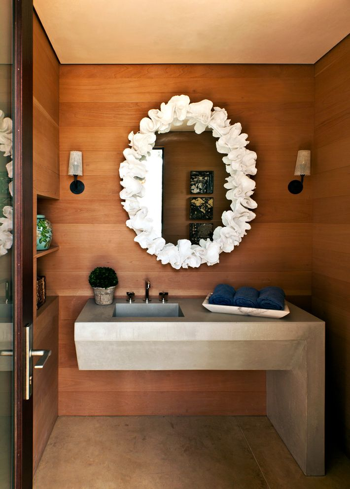 Bathrooms in Spanish with Modern Powder Room Also Cast in Place Concrete Counter Concrete Sink Mirror Oval Mirror Sink Wood Wall