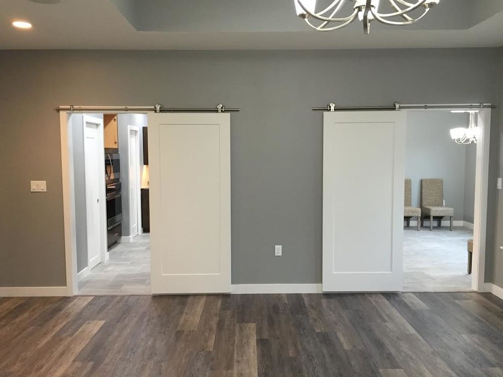 Bayport Flower House with Contemporary Hall  and Light Gray Wall Color Sliding Barn Door Sliding Barn Doors White Sliding Barn Door