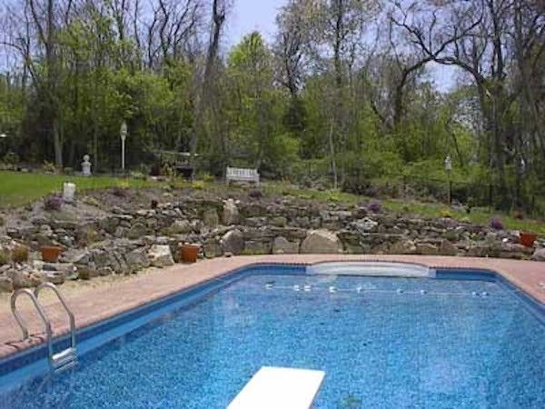 Bayport Flower House with Traditional Pool Also Backyard Landscaping Custom Landscaping Diving Board Outdoor Living Pool Landscaping Rock Hardscape