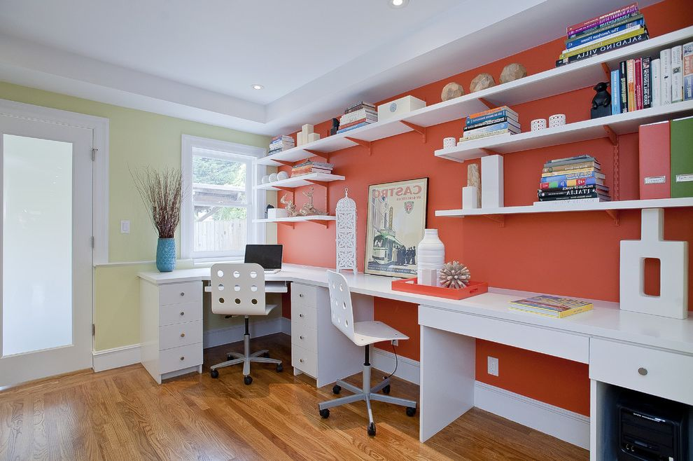 Beach Themed Office   Beach Style Home Office  and Built in Desks Casters Desk Chair Frosted Glass Open Shelves Orange Painted Brackets Recessed Lights Rolling Chairs Tray Ceiling White Painted Trim Wood Floor Yellow