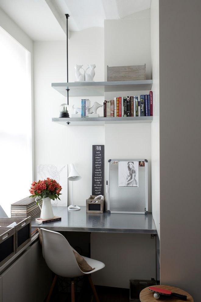 Beach Themed Office   Contemporary Home Office  and Bookshelves Bright Built in Desk Large Window Metal Molded Plastic Desk Chair Shelving Small Office Suspended White Walls Zinc