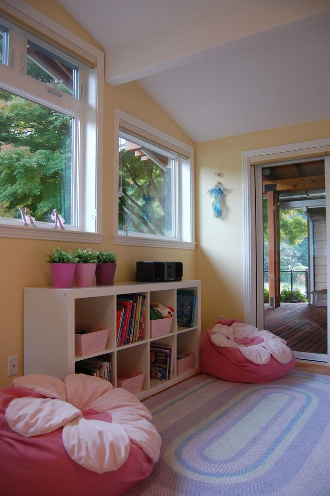 Bean Bags for Adults   Traditional Kids Also Bean Bag Chair Bedroom Bookcase Container Plants Cubbies Glass Doors Pink and Yellow Potted Plants Sliding Doors Sloped Ceiling Storage Vaulted Ceiling Yellow Wall