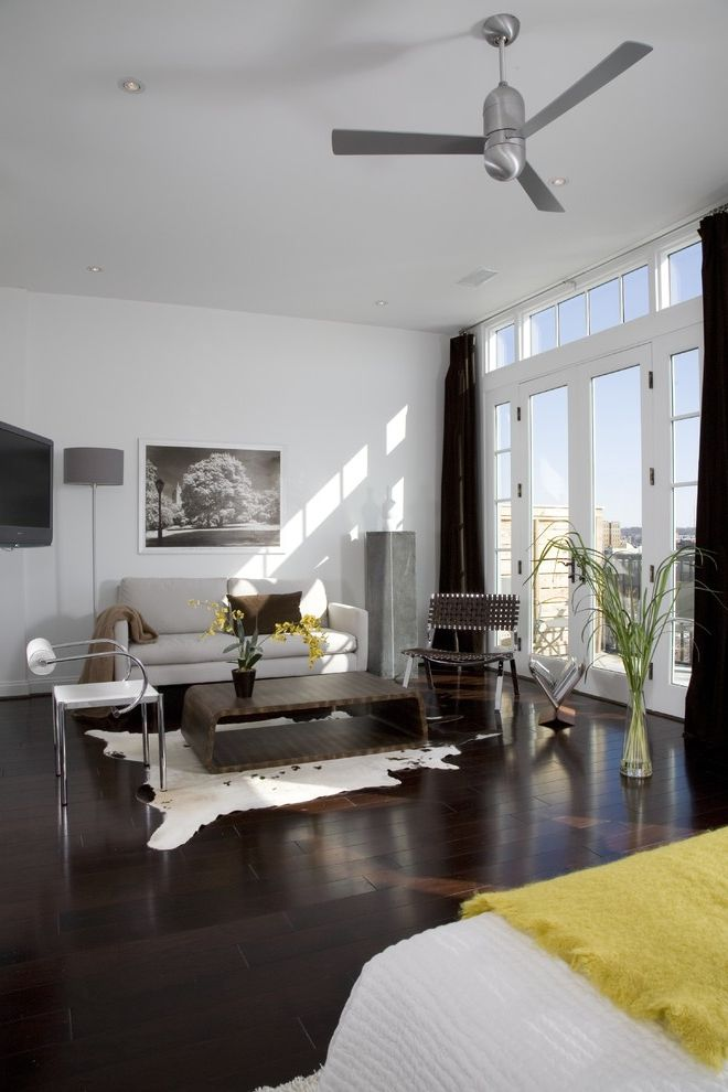 Bellawood Brazilian Cherry   Contemporary Bedroom Also Animal Rug Black and White Photography Ceiling Fan Coffee Table Curtain Panels Dark Stained Wood Floor French Doors Sofa Throw Transom Window Tv Woven Leather Chair