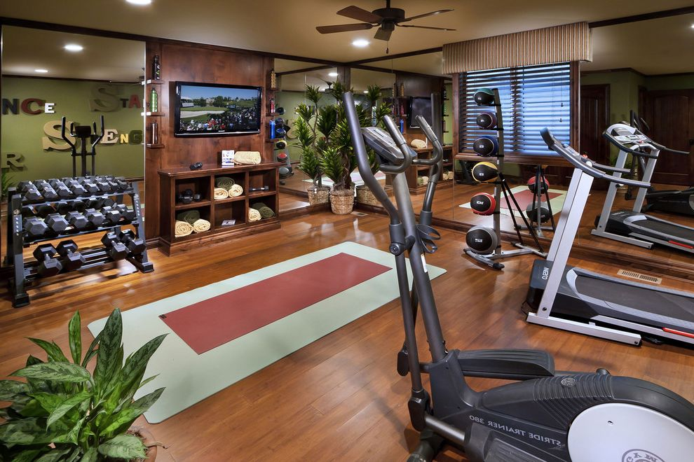 Benefits of Cork Flooring with Mediterranean Home Gym Also Built in Storage Ceiling Fan Free Weights Gym Equipment Houseplants Mirrored Walls Towel Storage Wall Mounted Tv Wood Flooring Wood Paneling Workout Mirror Yoga