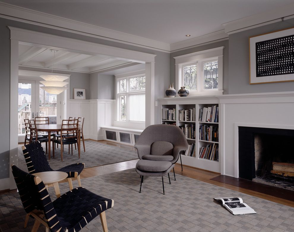 Benjamin Moore Decorators White   Traditional Living Room  and Area Rug Bench Seat Built in Bookshelf Dining Area Fireplace Frame and Panel Woodwork Gray Walls Leaded Glass Seating Area Wainscot White Painted Trim Wood Beams