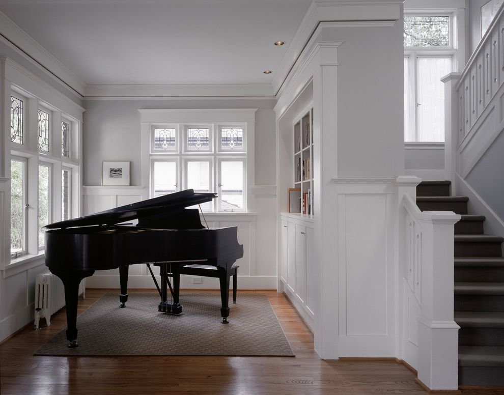Benjamin Moore Decorators White with Traditional Living Room  and Area Rug Frame and Panel Woodwork Fretwork Grand Piano Gray Leaded Glass Staircase Transom Windows Wainscot White Painted Wood Wood Floor
