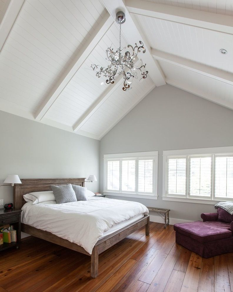 Benjamin Moore Gray Owl Oc 52 with Traditional Bedroom Also Cathedral Ceiling Chandelier Tongue and Groove Cieling Wall Sconce White Beams White Bedding White Ceiling White Shutters Wood Bed Frame