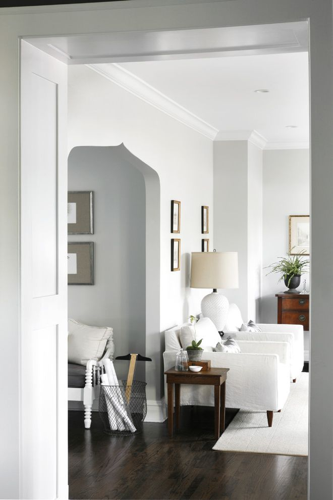 Benjamin Moore Gray Owl Oc 52 with Transitional Family Room Also Archways Crown Molding Gray Walls Grey Walls Lamp Neutral Colors T Square Walk Through Detail White Armchairs White Trim Wire Basket Wood Floors