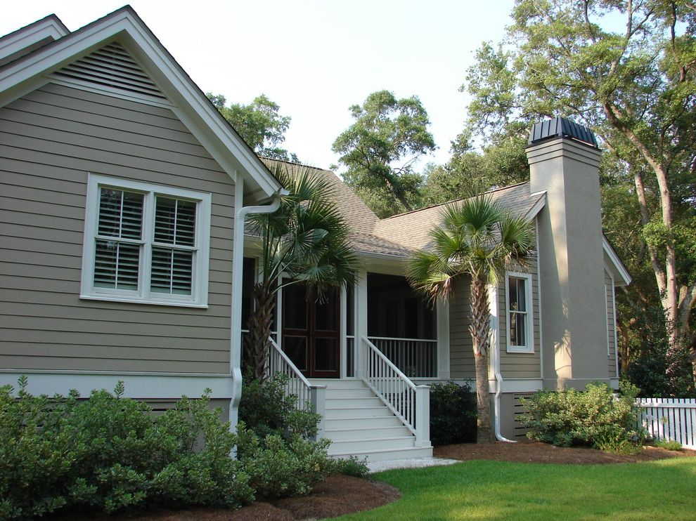 Benjamin Moore Greenbrier Beige   Traditional Exterior Also Beige Exterior Beige Siding Beige Stucco Chimney Landscape Mixed Materials Palm Tree Shrubs Trees White Column White Fence White Pillar White Railing White Stairs