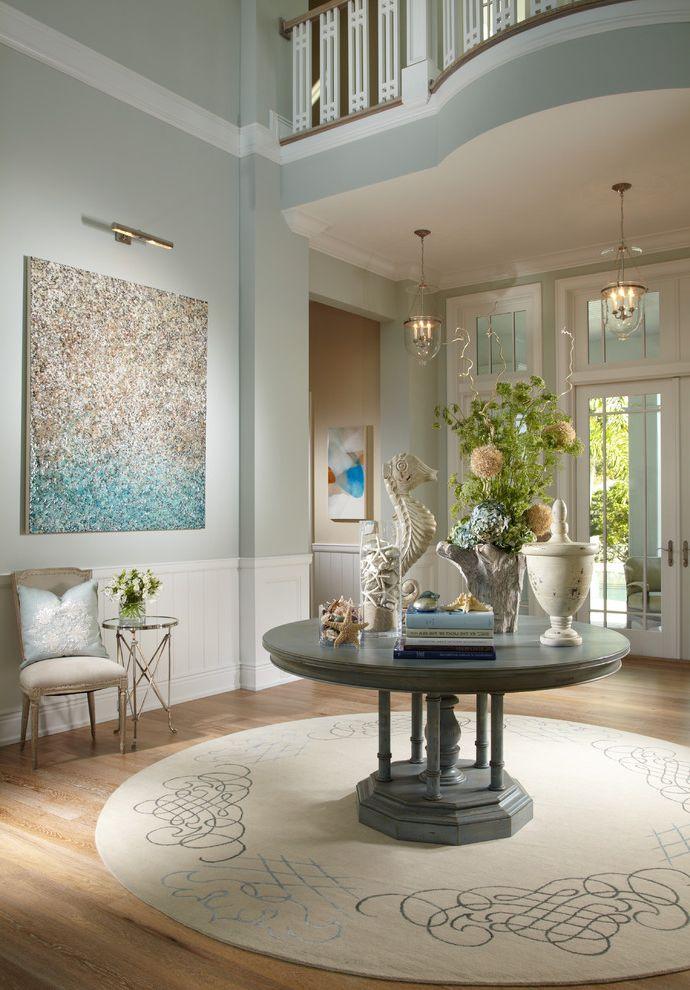 Benjamin Moore Greenbrier Beige   Tropical Entry  and Accessories Area Rug Art Foyer Glass Doors Lighting Neutral Railing Table Wood Floor
