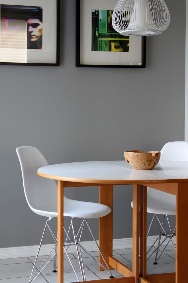 Benjamin Moore Stormy Monday   Contemporary Dining Room Also Artwork Cage Light Eat in Kitchen Floor Tile Grey Walls Kitchen Tile Molded Plastic Chair Oval Dining Table Pendant Lighting Wall Art Wall Decor