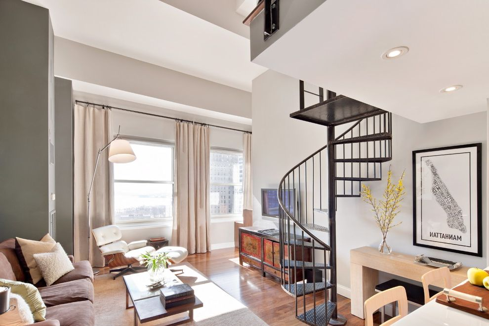 Benjamin Moore Stormy Monday   Contemporary Living Room  and Area Rug City View Counter Stools Curtain Panels Gray Accent Wall Lofted Ceilings Manhattan Pillows Recessed Lights Seating Area Sofa Spiral Staircase Tall Ceilings White Walls Wood Floor