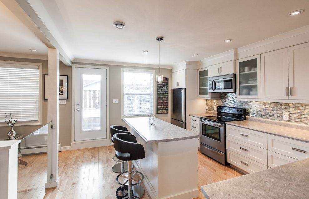 Benjamin Moore Stormy Monday with Contemporary Kitchen Also Artwork Backsplash Beige Blinds Counter Stools Glass Panel Railing Kitchen Island Light Gray Pendant Lights Stainless Steel White Trim Wood Floor