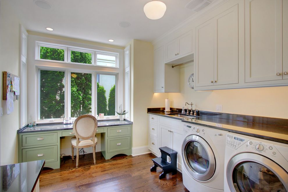 Best Dryer for the Money   Traditional Laundry Room Also Black Counters Desk Area Drawer Pulls Dryer Green Painted Desk Step Stool Washer White Appliances White Cabinets Windows Wood Floor