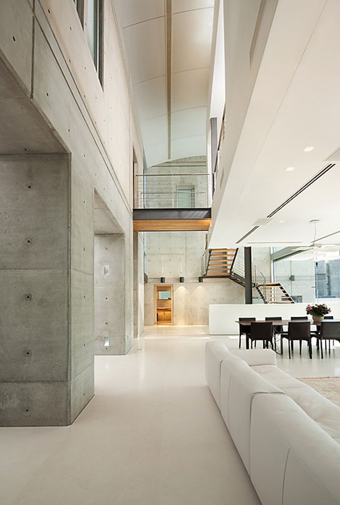 Best Flooring for Concrete Slab   Industrial Hall Also Atrium Balcony Concrete Wall Great Room Industrial Interior Windows Loft Minimal Monochromatic Neutral Colors Open Floor Plan Sloped Ceiling Staircase Vaulted Ceiling