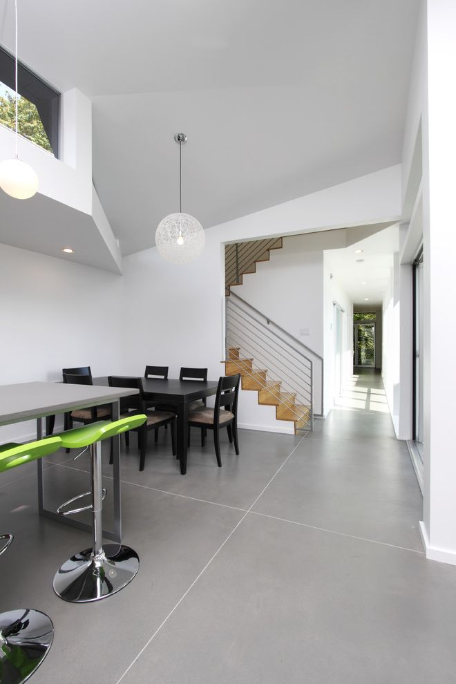 Best Flooring for Concrete Slab   Modern Dining Room Also Clerestory Windows Dining Area Lime Green Bar Stools Lofted Ceiling Metal Railing Pendant Lights Polished Concrete Floor Staircase White