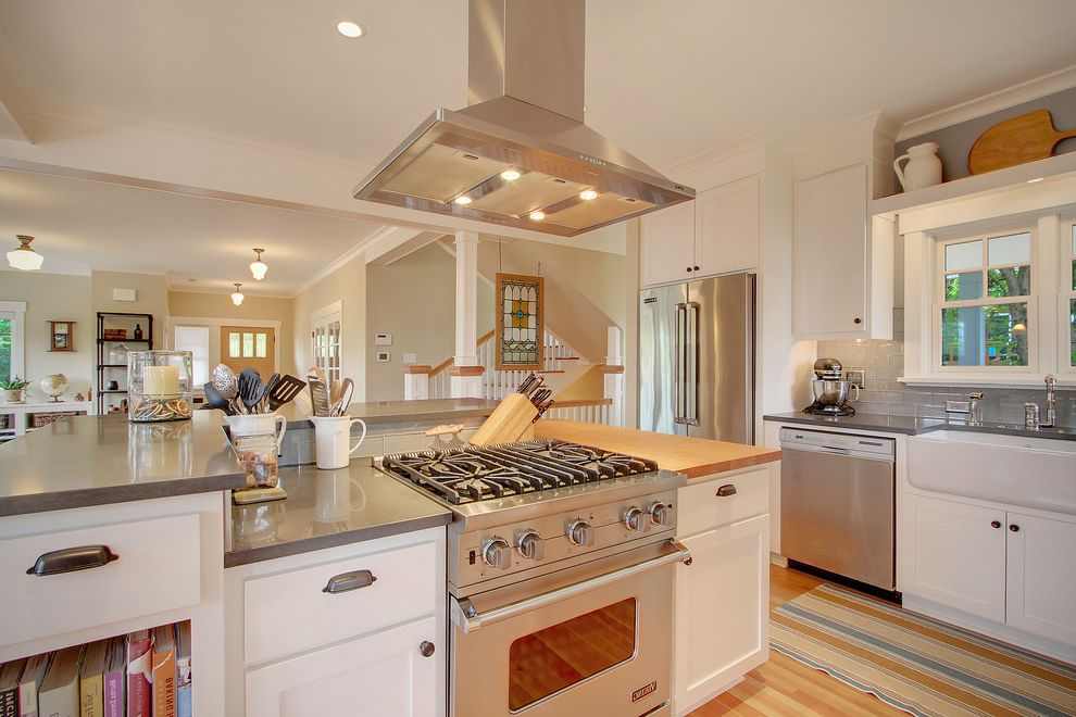 Best Induction Range with Craftsman Kitchen  and Apron Sink Craftsman Drawer Pulls Gray Counters Gray Subway Tile Backsplash Hood Pendant Lights Stained Glass Stainless Stairs White Cabinets Wood Floor