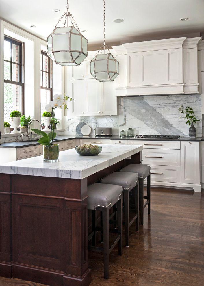 Best Induction Range with Traditional Kitchen  and Dark Wood Island Gray Marble Backsplash Silver Leather Barstool Silver Pendant Light White Range Hood