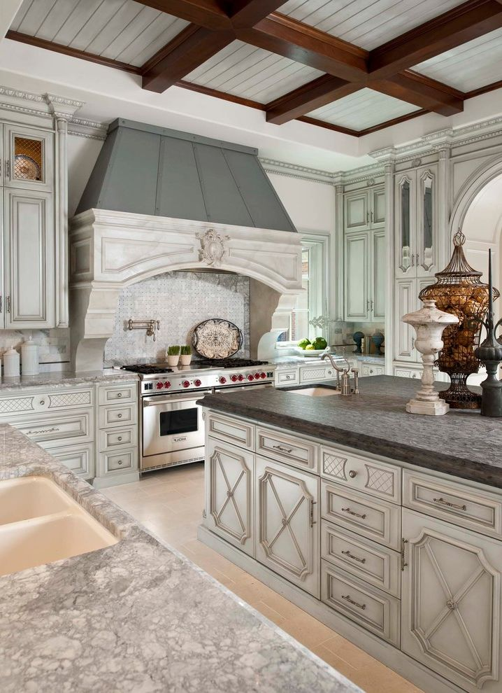 Best Movers in Dallas   Mediterranean Kitchen  and Arched Opening Beamed Ceiling Coffered Ceiling Dallas Design Group Hood Range Kitchen Marble Countertops Ornate Cabinetry Range Stainless Appliamces Stainless Steel Faucet Tracy Rasor Wood Beams
