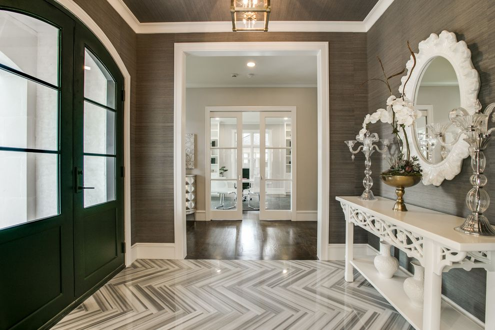 Best Movers in Dallas with Transitional Entry  and Arch Doorway Candlesticks Console Table Elegance Framed Wall Mirror Grass Cloth Gray Grey Herringbone Tile Floor Orchids Wallpaper