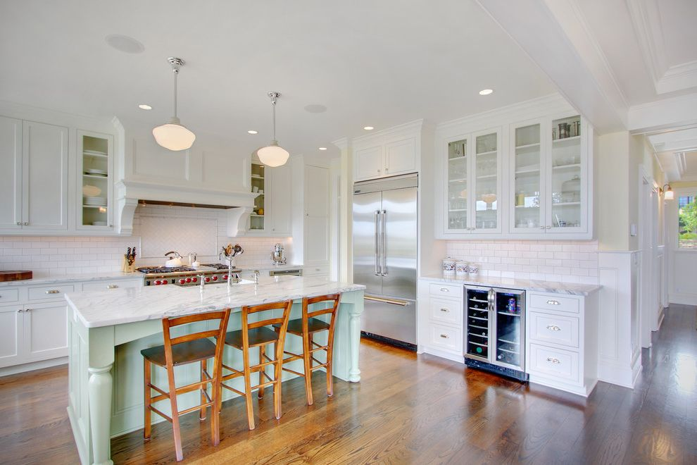 Best Refrigerators 2015 with Traditional Kitchen Also Backsplash Beverage Cooler Counter Stools Crown Molding Glass Front Cabinets Good Island Marble Pendant Lamps Range Recessed Panel Cabinets Robins Egg Blue Stainless Subway Tile White Wood Floor