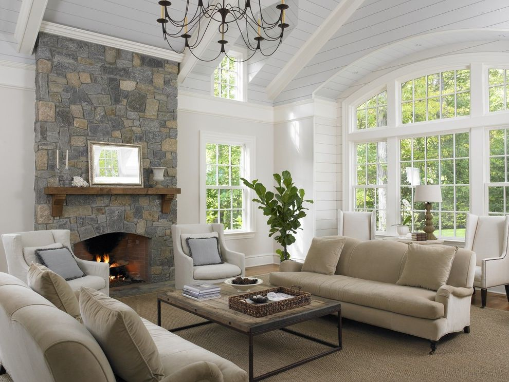 Best Way to Wash Windows with Traditional Family Room Also Beige Sofa Chandelier Pale Blue Ceiling Rustic Wood Coffee Table Sisal Rug Stone Fireplace Tray Vaulted Ceiling White Armchair Wood Mantel Wood Paneling