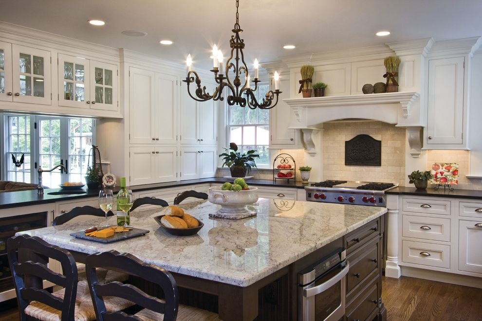 Bianco Romano Granite Countertops   Traditional Kitchen  and Breakfast Bar Chandelier Crown Molding Dining Hutch Eat in Kitchen Kitchen Island Range Hood Undercabinet Lighting White Trim Wood Floors