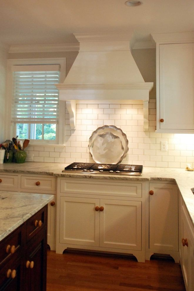 Bianco Romano Granite Countertops   Traditional Kitchen  and Cooktop Gas Cooktop Hood Inset Kitchen Painted Subway Tile Subway Tile Backsplash White White Subway Tile Wooden Knobs
