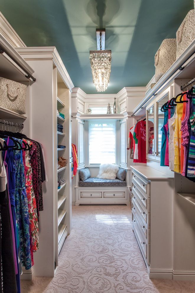 Big Closet Top Shelf   Traditional Closet Also Adjustable Shelves Blue Ceiling Built in Bench Closet Organization Clothes Hangers Dream Closet Large Closet Luxury Patterned Carpet White Drawers White Shelves Window