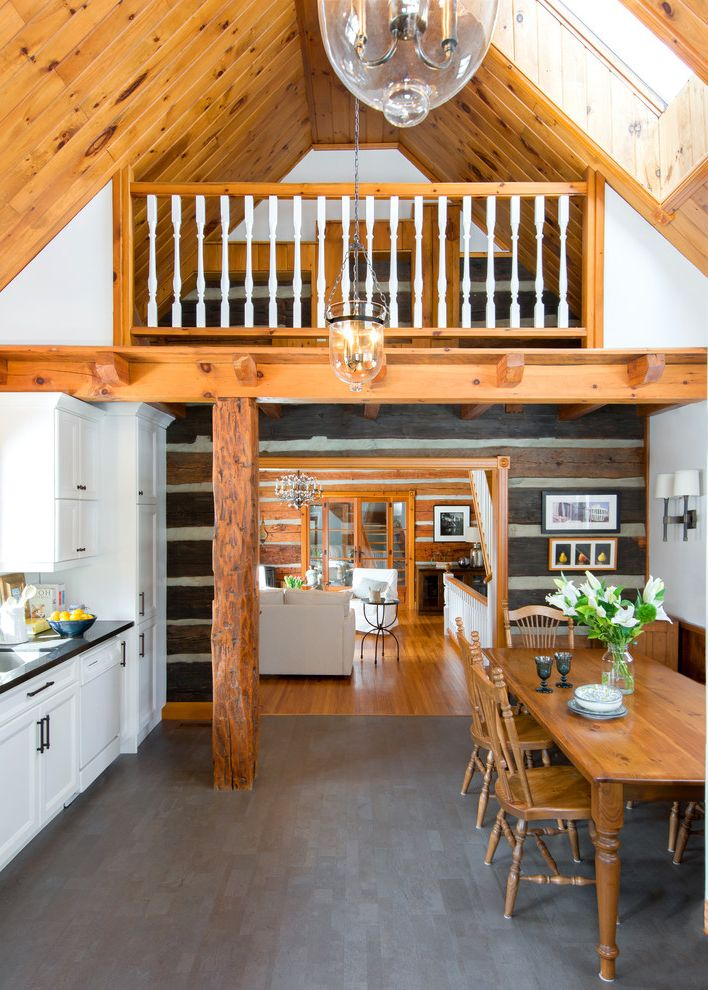 Big Cork Winery   Rustic Kitchen  and Balcony Chinking Cork Flooring Eat in Kitchen Gray Floor Tile Hurricane Lanterns Log Cabin Kitchen Rough Hewn Wood Skylight Vaulted Ceiling