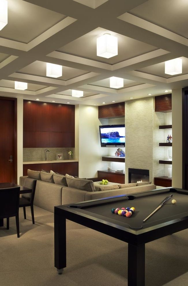 Black Semi Flush Mount Ceiling Light with Contemporary Family Room Also Black Billiards Table Black Pool Table Built in Wet Bar Coffered Ceiling Gray Carpet Gray Sectional Sofa Inset Fireplace Open Shelves Sink Tv