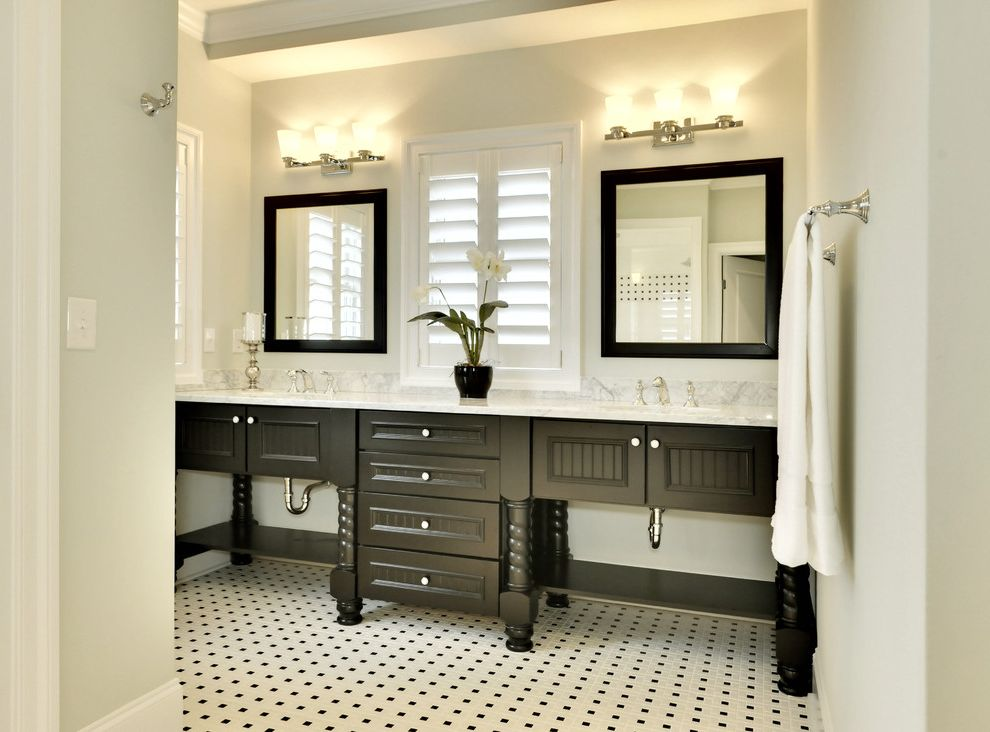 Black Vanity Light Fixtures with Beach Style Bathroom  and Bathroom Mirrors Black and White Double Sinks Double Vanity Floor Tile Design Orchid Plantation Shutters Sconce Tile Flooring Wall Lighting White Wood Window Treatments Wood Cabinets Wood Trim