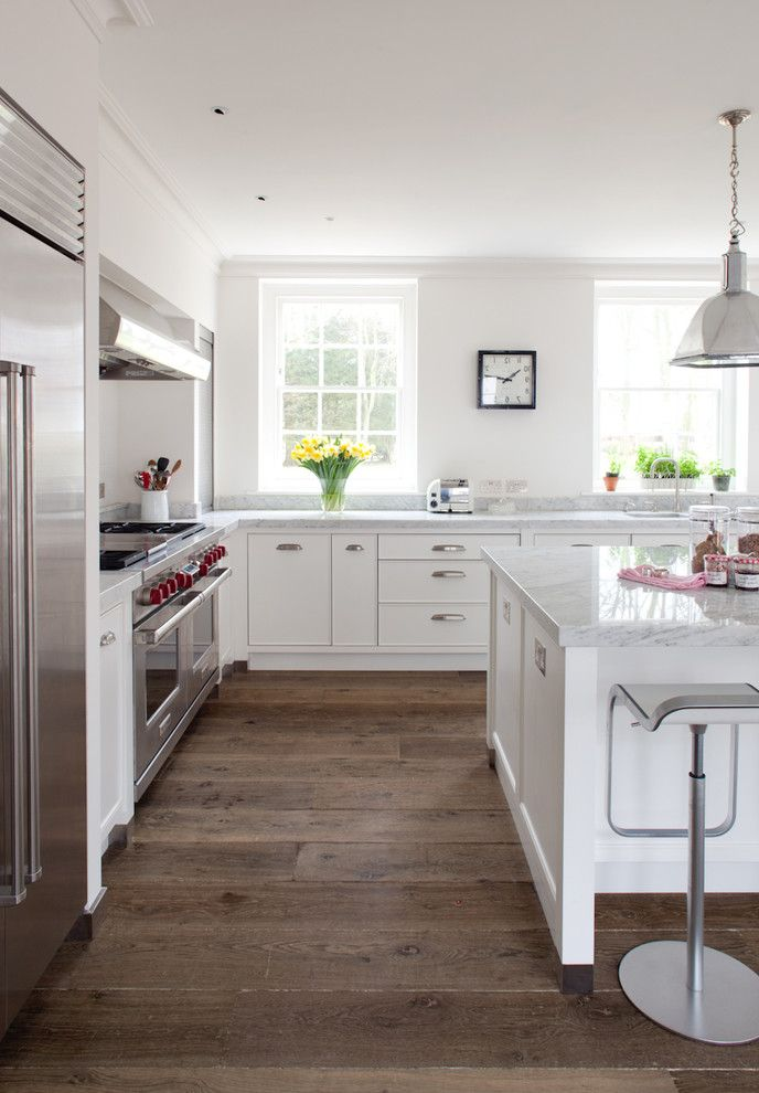 Blakely Flooring with Farmhouse Kitchen Also Bin Pulls Clock Cup Pulls Hand Painted Handcrafted Cabinets Hood Kitchen Island Marble Worktops Pendant Lights Sub Zero Wolf Appliances Wide Plank Flooring